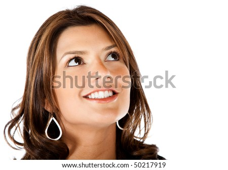 Thoughtful woman portrait smiling - isolated over a white background