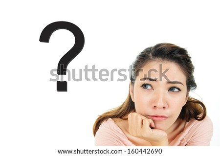 Thoughtful woman with question mark  - stock photo