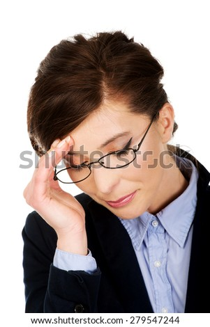 Thoughtful worried businesswoman touching her head. - stock photo