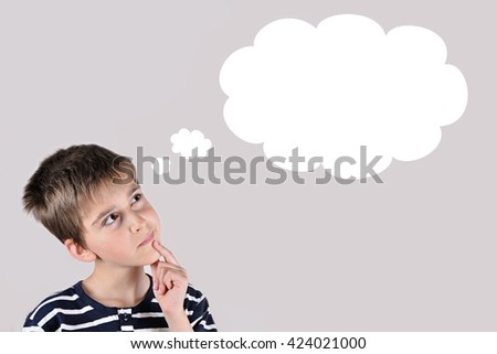 Thoughtful young boy with an empty thought bubble - stock photo