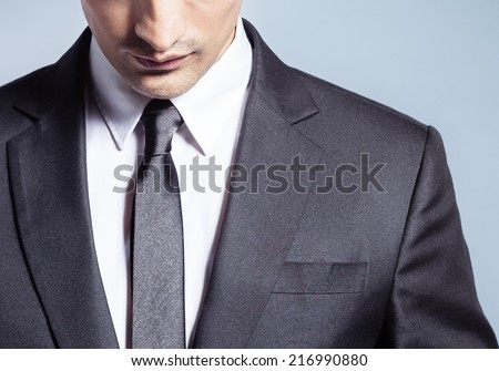 Thoughtful young business man - stock photo