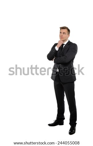 Thoughtful young business man looking up. - stock photo