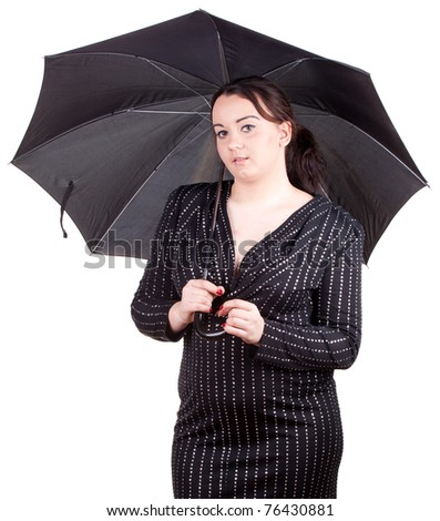 thoughtful young fat woman with black umbrella - stock photo