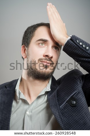 Thoughtful young man - stock photo