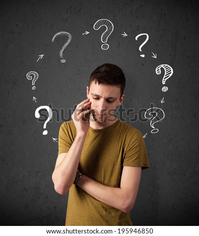 Thoughtful young man with drawn question marks circulating around his head - stock photo