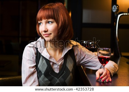 Thoughtful young woman learning on the bar counter. - stock photo
