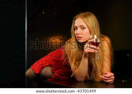 Thoughtful young woman lying on the bar counter. - stock photo