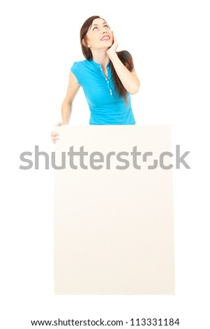 thoughtful young woman with empty poster looking up, white background - stock photo