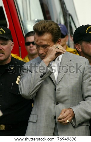 THOUSAND OAKS, CA - SEPT. 30: Arnold Schwarzenegger at a press conference in Thousand Oaks after taking a helicopter tour of the Topanga Canyon fire, north of Los Angeles, California, September 30, 2005 - stock photo