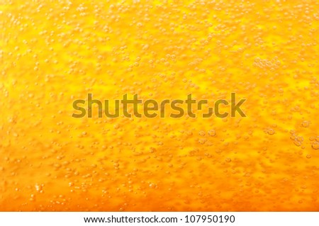 Thousands of small bubbles in beer.