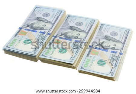 thre piles of dollars money isolated on white background - stock photo