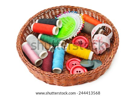 thread and buttons in a basket isolated on white background - stock photo