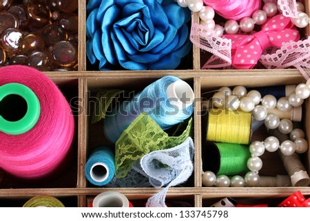 thread and material for handicrafts in box close-up - stock photo