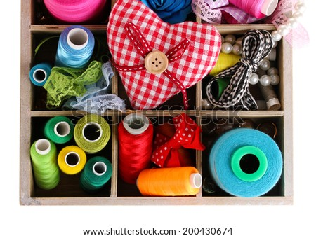 thread and material for handicrafts in box isolated on white - stock photo