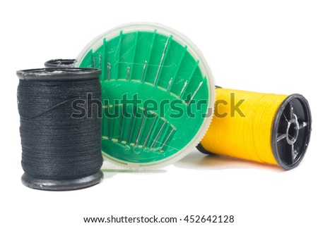 thread and sewing needle isolated on white background