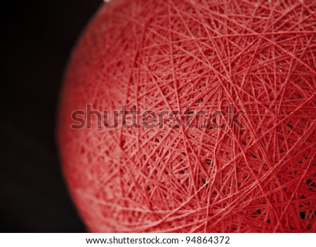 Thread ball isolated on black background - stock photo
