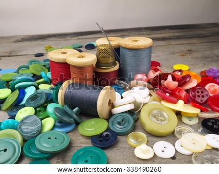 thread bobbins among buttons  - stock photo
