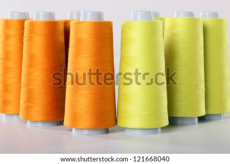 Thread bobbins for sewing projects - stock photo