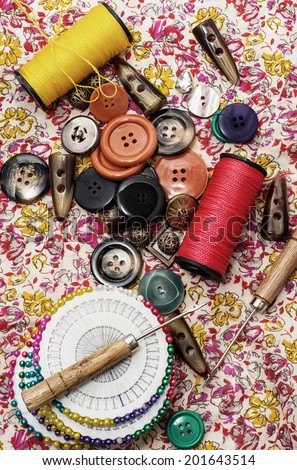 thread,button,crochet hook, and other sewing tools - stock photo