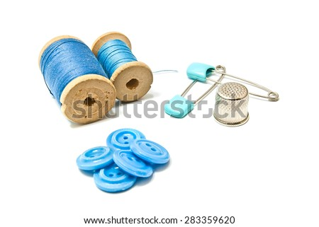 thread, buttons and thimble on white closeup - stock photo