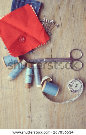 thread for sewing, supplies and accessories for sewing on a light wooden table
