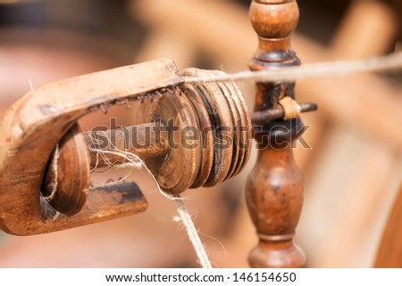 Thread in the Old spinning wheel  - stock photo