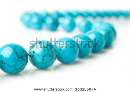thread turquoise beads closeup isolated on white - stock photo