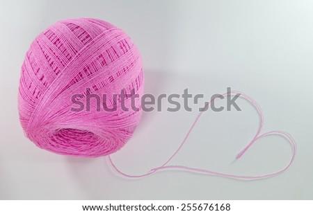 thread with heart shape thread - stock photo