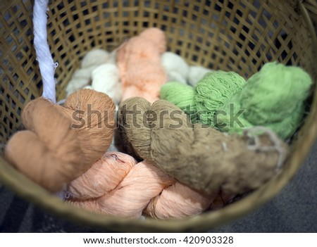 threads multicolored in wood basket - selective focus. - stock photo