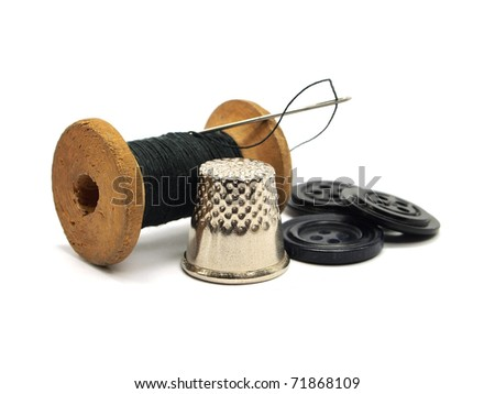 threads, needle, buttons and thimble on a white background - stock photo