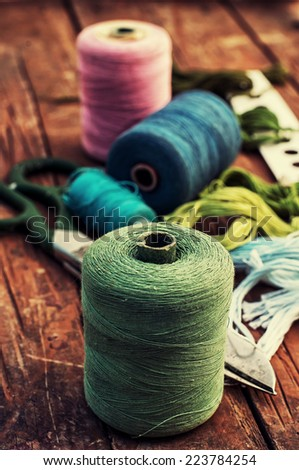 threads of different types,colors and lengths  - stock photo