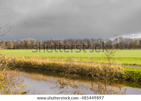 threatening sky above Valleikanaal, cycle path and  the meadows of Leusden, The Netherlands