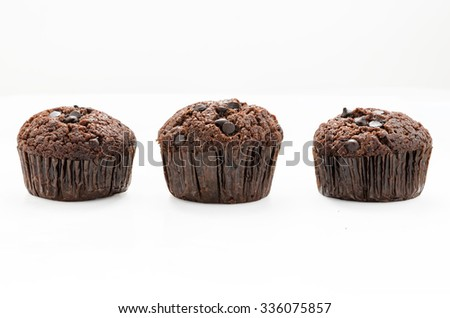 Three abreast of chocolate muffins on white background with clipping path