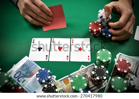 three aces on green table. close up - stock photo