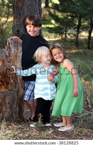 three adorable children in outdoor setting