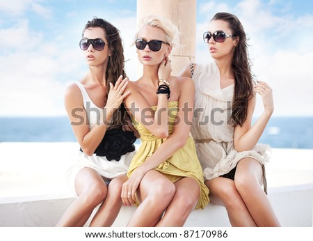 Three adorable women on vacation day - stock photo