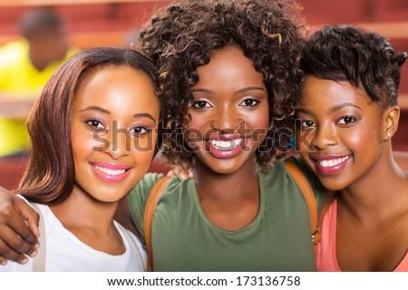 three african college friends closeup portrait - stock photo