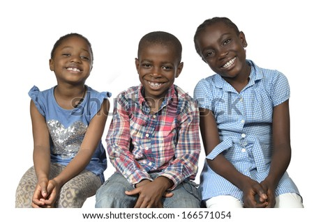 Three african kids holding on another smiling, Studio Shot - stock photo