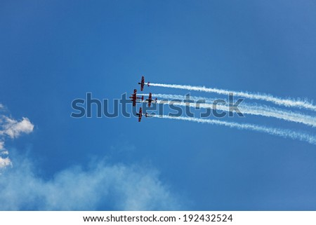 Three airplane fly across the clear sky - stock photo