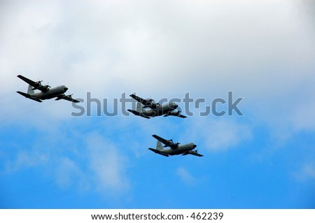 Three airplanes of the belgium army flying over.