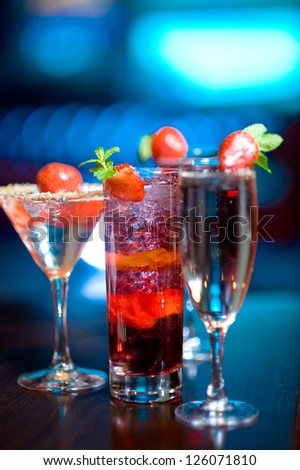 Three alcoholic cocktails with strawberry - stock photo