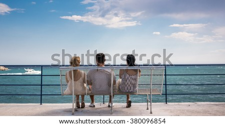 Three amigos watching the boats go by - stock photo