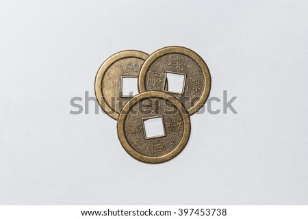 three ancient chinese coins isolated on white background - stock photo