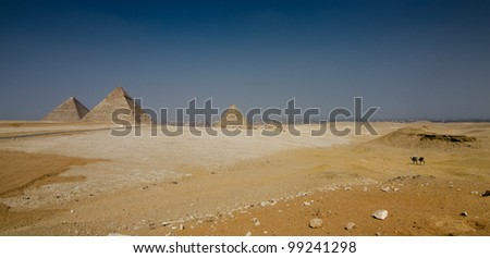 Three ancient pyramids in Giza overlooking Cairo