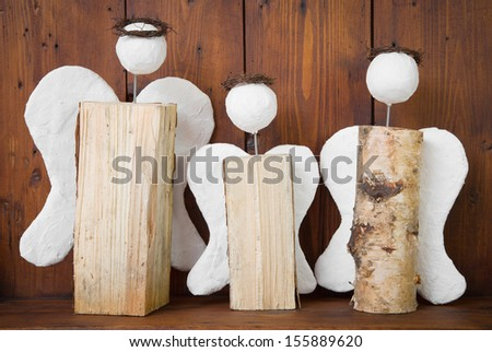 Three angel made of wood - stock photo