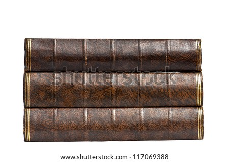 Three antique books stacked on their side so their plain spines only are visible. Shot on white as an isolation. Horizontal format with copy space. - stock photo