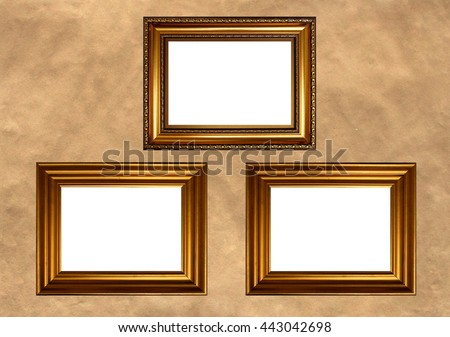 Three antique golden frames with white copy space on vintage background - stock photo