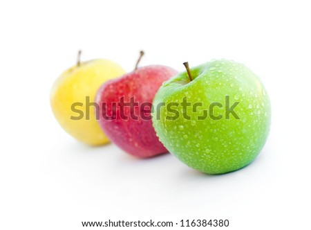 Three apples, green, red and yellow