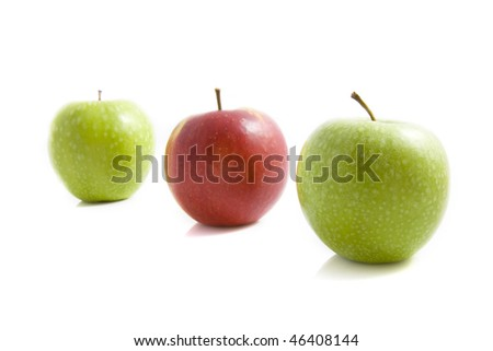 Three apples in a row isolated over white