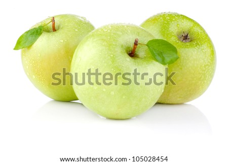 Three apples with green leaves and water drops on a white background